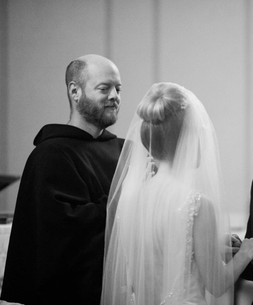 Rob stood in as the officiant, his robe was handmade and beautiful, but it was hard not to laugh.
